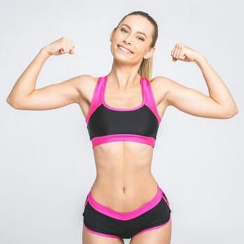 woman wearing gym clothes with her both arms flexing