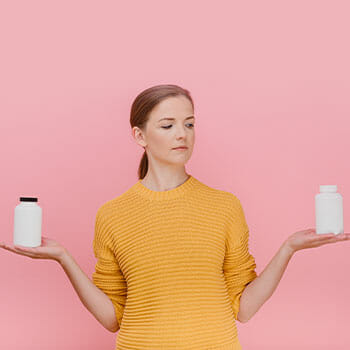 woman holding up two different bottles