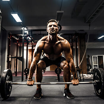 A guy performing a deadlift