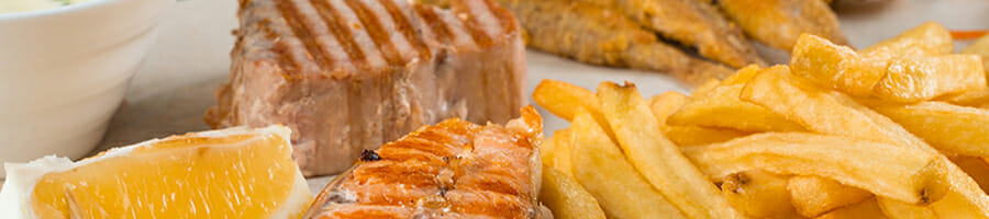 Grilled salmon steak with french fries
