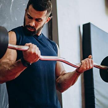 A man lifting an EZ bar